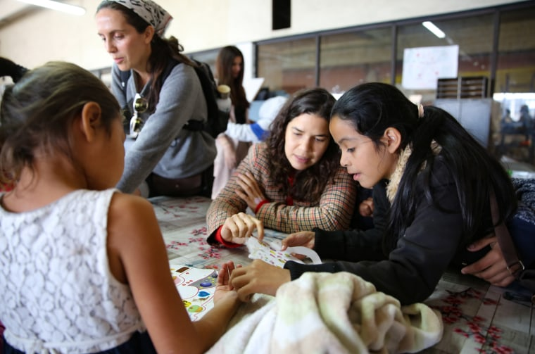 Image: America Ferrera speaks with migrants at a shelter in Tijuana, Mexico.