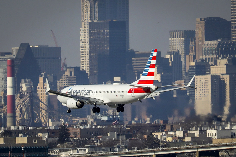 Image: An American Airlines Boeing 737 Max 8 lands at LaGuardia Airport in Queens, New York, on March 11, 2019.