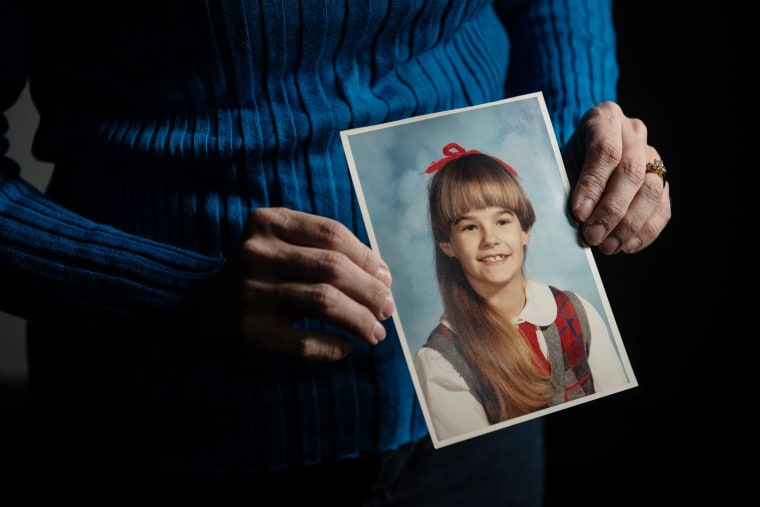 Jennifer Goetz holds a photo of herself from around the time when she said Barto violated her.Justin Merriman / for NBC News
