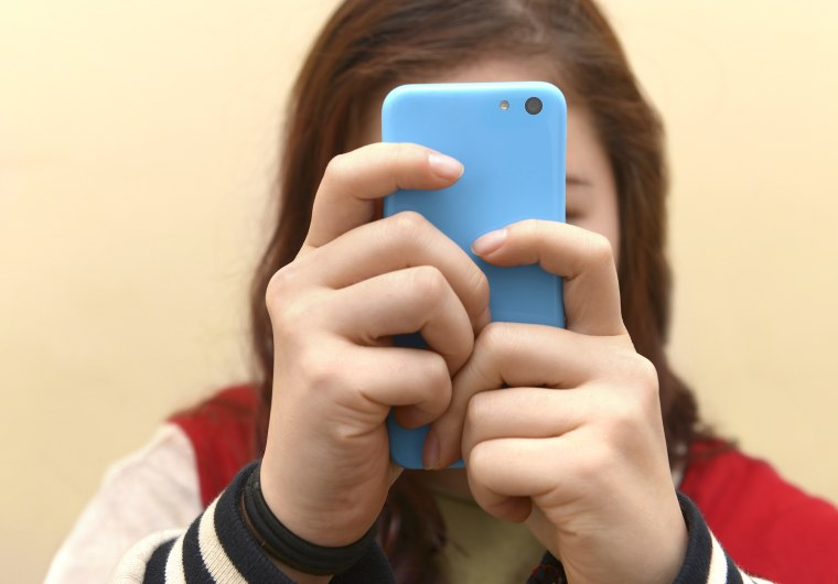 Image: Close up of a teenager on her smartphone