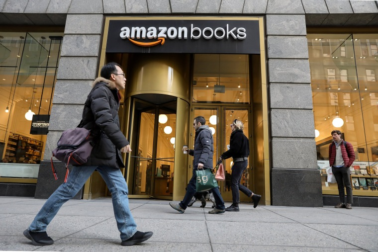 Image: People walk past an Amazon Books retail store in New York