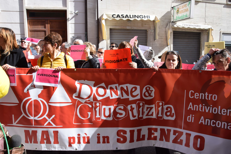 Image: A demonstration outside Ancona's court after it emerged that two men accused of rape were cleared by female judges because the alleged victim looked ''masculine''