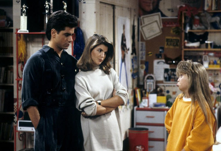 "Image: John Stamos, Lori Loughlin and Candace Cameron appear in a 1989 episode of ""Full House."""