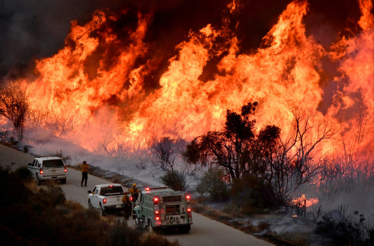 Image: Fire fighters attack the Thomas Fire?EUR(TM)s north flank with backfires as they continue to fight a massive wildfire north of Los Angeles, near Ojai , California