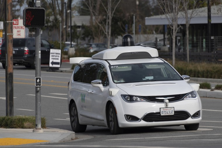 Image: A Waymo self-driving test vehicle on the road in Mountain View, California