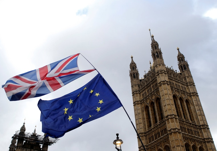 Image: Flags flutter outside the Houses of Parliament, ahead of a Brexit vote, in London, Britain
