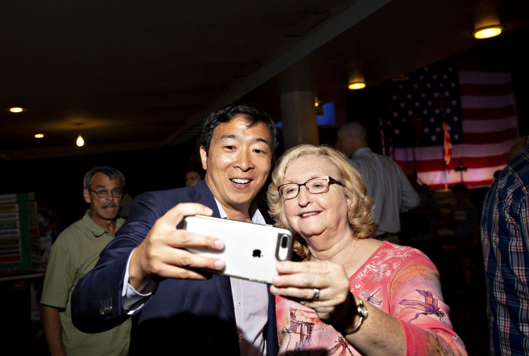 Image: Andrew Yang takes a selfie with an attendee at the Democratic Wing Ding event in Clear Lake, Iowa, on Aug. 10, 2018.