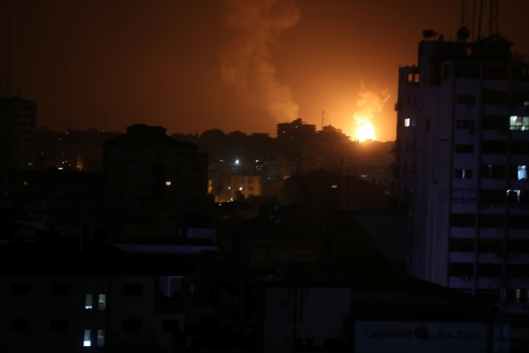 Image: Smoke and flame are seen during an Israeli air strike in Gaza