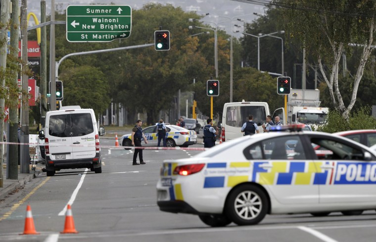Image: Police stand outside a mosque in Linwood, Christchurch, New Zealand, Friday, March 15, 2019. Multiple people were killed during shootings at two mosques full of people attending Friday prayers