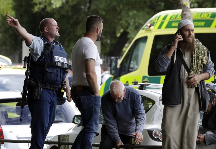 Image: Police attempt to clear people from outside a mosque in central Christchurch, New Zealand,