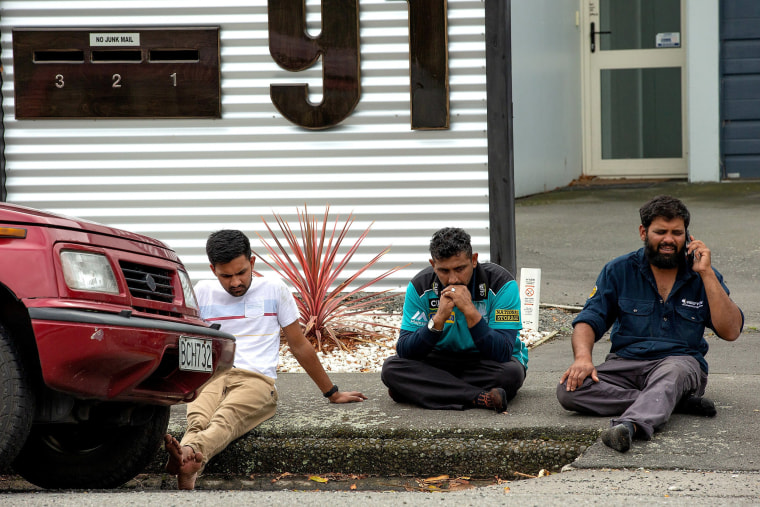 Image: Grieving members of the public following a shooting at the Al Noor mosque in Christchurch