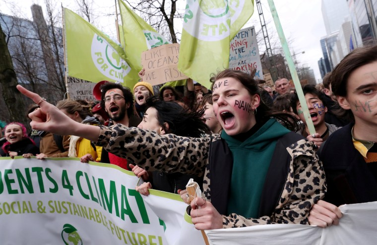 Image: Demonstrators take part in a protest against climate change in central Brussels