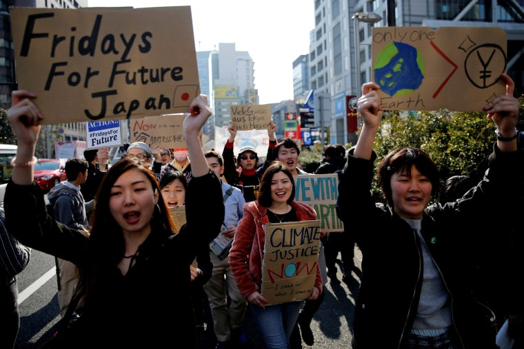 Image: School students march with signs during the global  students strike for action on climate change in Tokyo