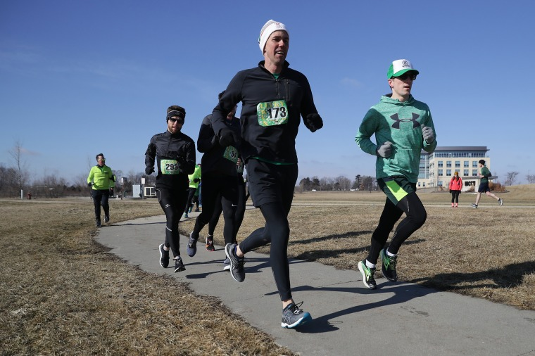 Image: Beto O'Rourke participates in the Lucky Run 5k Race in North Liberty, Iowa, on March 16, 2019.