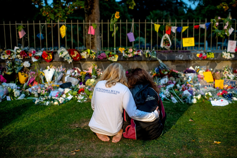 Image: Women comfort each other near a memorial for the victims killed in a shooting in Christchurch, New Zealand, on March 17, 2019.