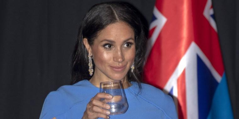 Meghan's blue cape dress in Fiji