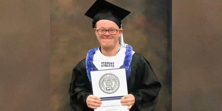 Cody Sullivan, who has Down syndrome, holds his certificate from Concordia University.