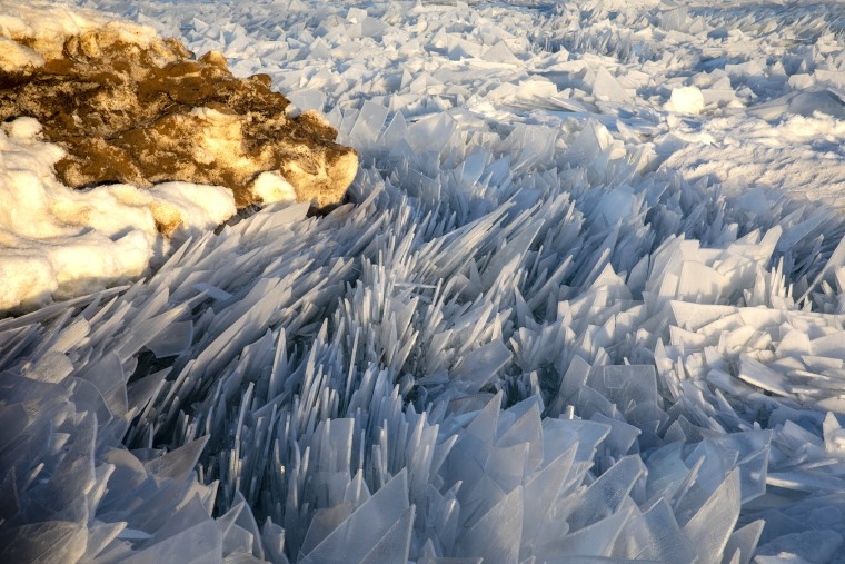 Frozen Lake Michigan thaws into crazy looking blue ice shards
