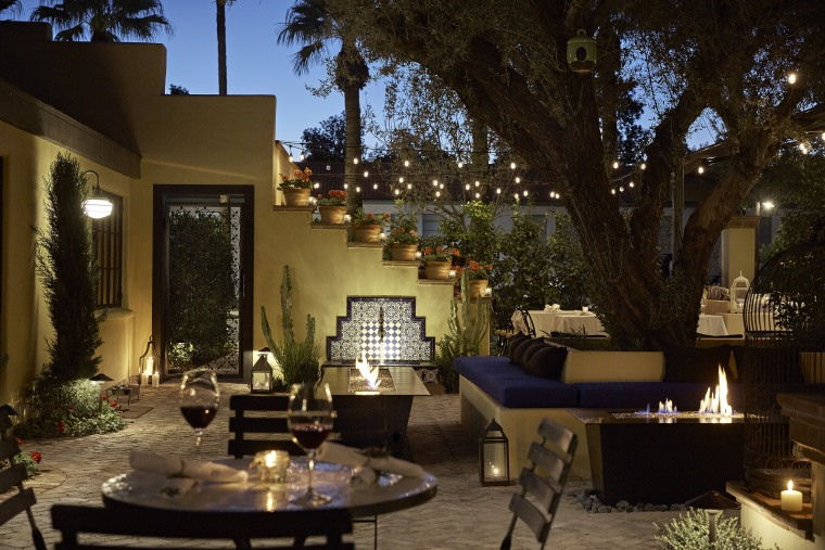 romantic dinner setting in a courtyard at Bespoke Inn in Santa Fe, New Mexico