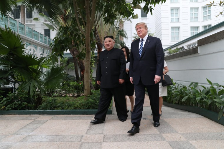 Image: U.S. President Donald Trump and North Korea's leader Kim Jong Un walk in the garden at the Metropole hotel during the second North Korea-U.S. summit in Hanoi