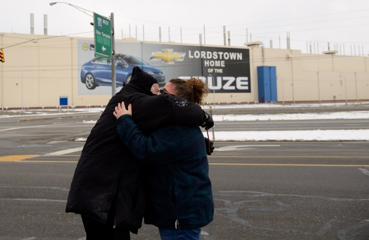 Image: Werner Lange greets Melissa Valinsky, who had just finished her last day after working at the GM Lordstown plant for 24 years, in Ohio on March 6, 2019.