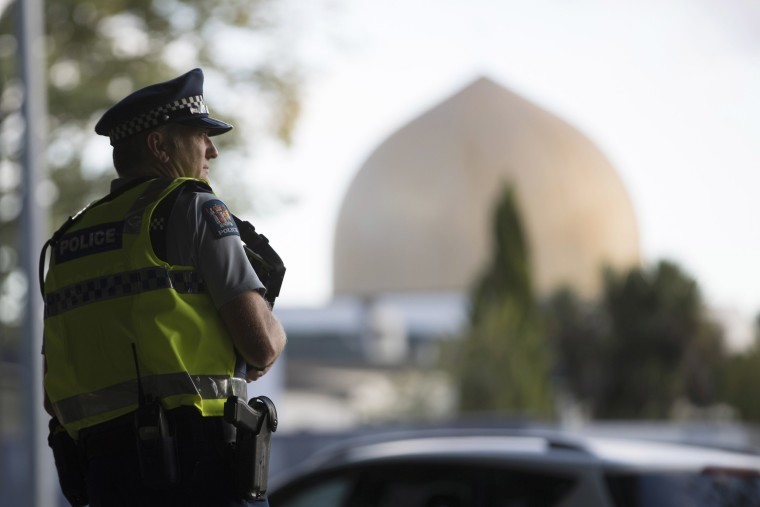 Image: A police official stands guard in front of the Al Noor mosque in Christchurch, New Zealand