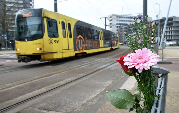 Image: Flowers have been set up in tribute to victims at the site of a shooting in a tram, at 24 October square in Utrecht,