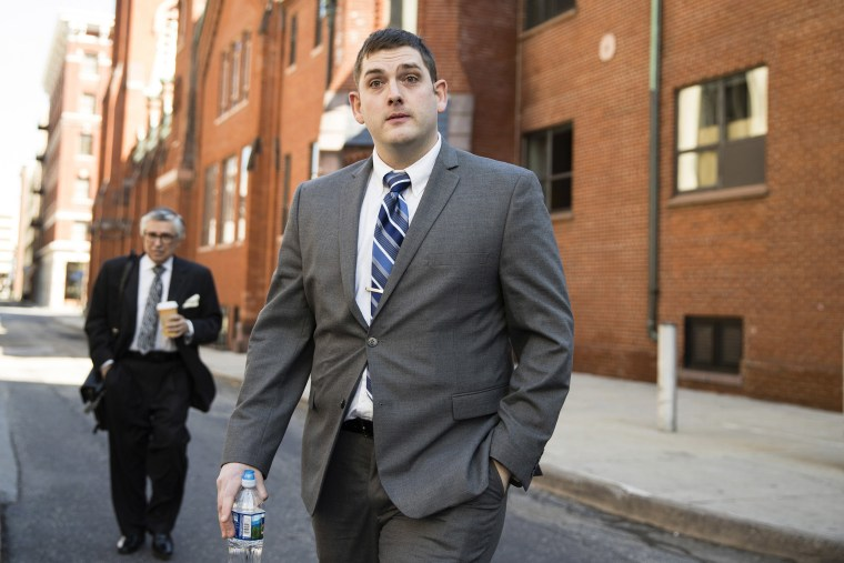 Image: Former East Pittsburgh police officer Michael Rosfeld, charged with homicide in the shooting death of Antwon Rose II, arrives at the Dauphin County Courthouse in Harrisburg