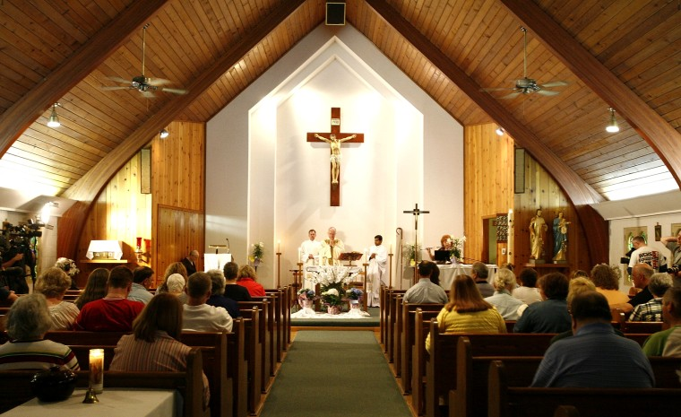 Image: Bishop Michael Bransfield of the Wheeling-Charleston Roman Catholic Diocese leads mass in Montcoal, West Virginia, on April 6, 2010.