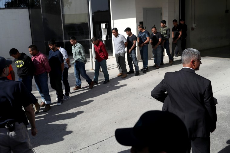 Image: Undocumented immigrants leave a U.S. federal court in shackles in McAllen, Texas, on June 11, 2018.