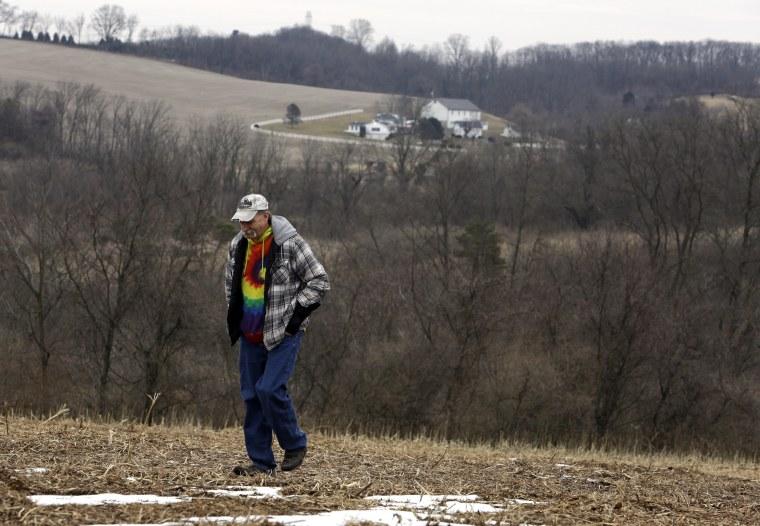 Image: Mike Carpenter, the uncle of Greg Longenecker, walks in the field where Longenecker was killed by a bulldozer in Bernville, Pennsylvania, on Feb. 23, 2019.