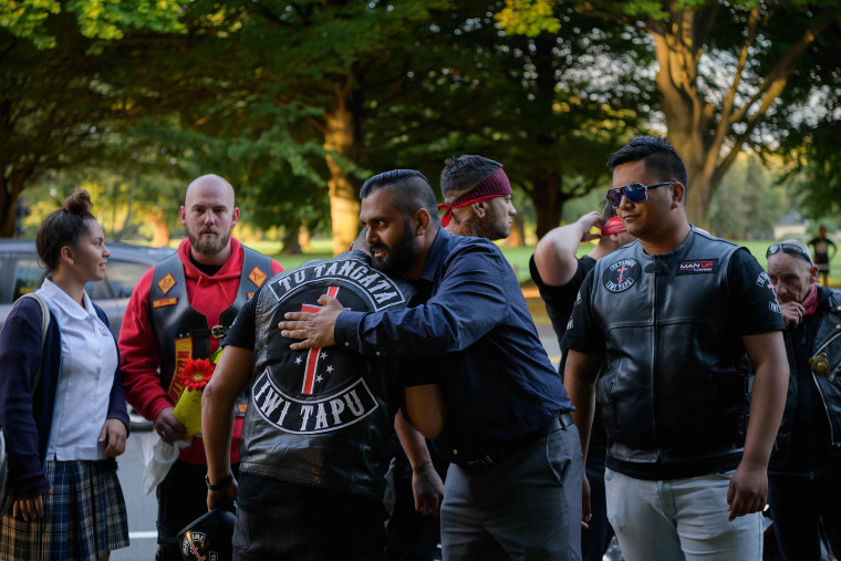 Image: Members of biker gangs arrive before performing the haka in front of a gathering of people as a tribute to victims in Christchurch