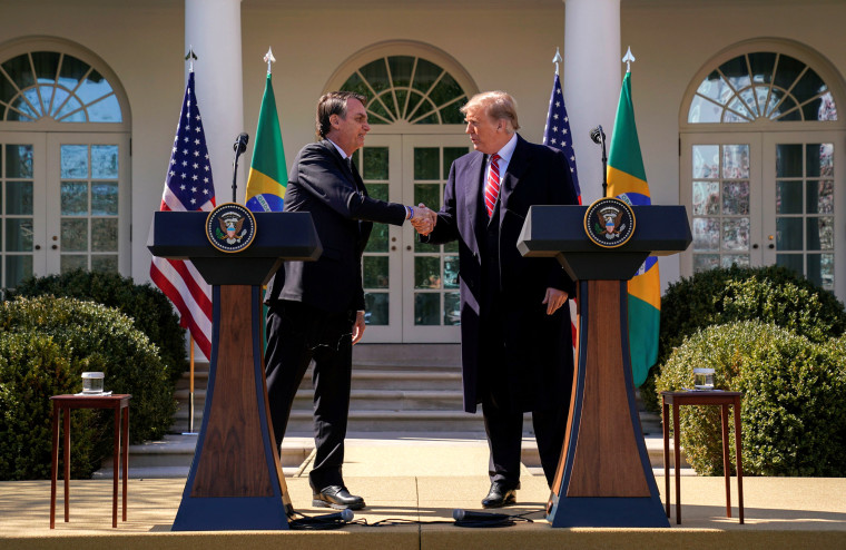 Image: Brazil's President Jair Bolsonaro and President Donald Trump shake hands during a news conference in the Rose Garden of the White House on March 19, 2019.
