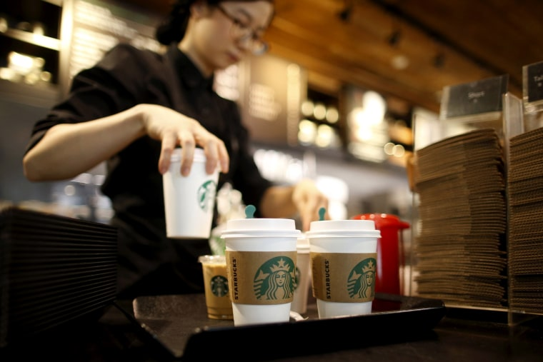 Image: An employee at a Starbucks in Seoul, South Korea, in 2016.