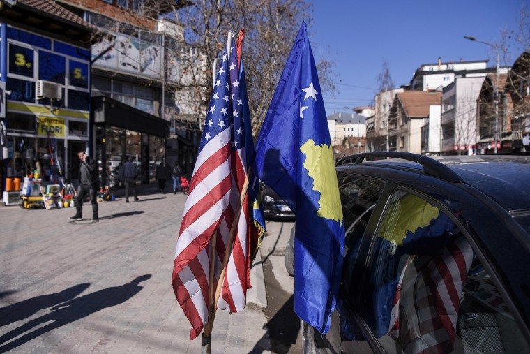Image: U.S. and Kosovo flags displayed for sale in the street in the town of Mitrovica