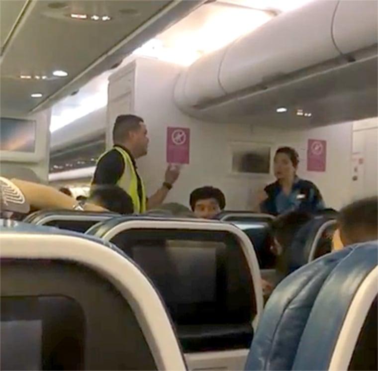 Passengers on a flight from Hawaii to Los Angeles had to deplane because of an altercation between other passengers.