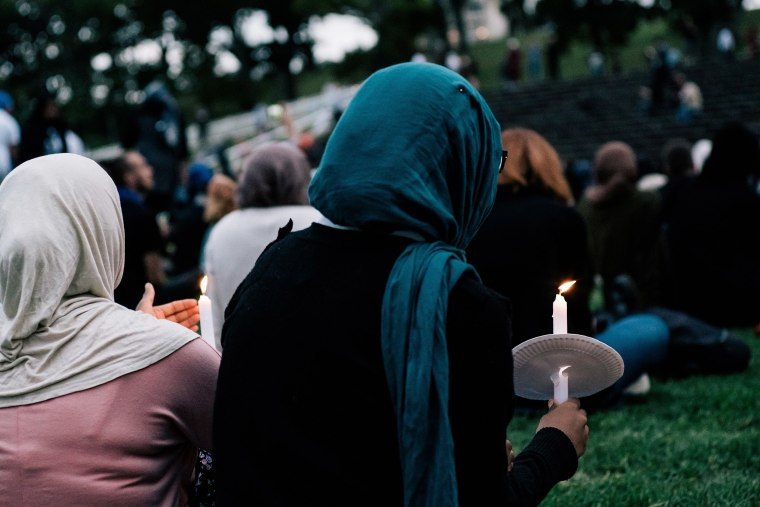 Image: People attend a vigil for the lives taken in the Christchurch terror attacks at the Auckland Domain on March 22, 2019 in Auckland