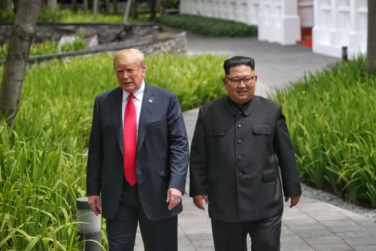 Image: U.S. President Donald Trump walks with North Korean leader Kim Jong Un at the Capella Hotel on Sentosa island in Singapore