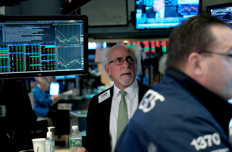Image: Traders work on the floor of the New York Stock Exchange on March 25, 2019.