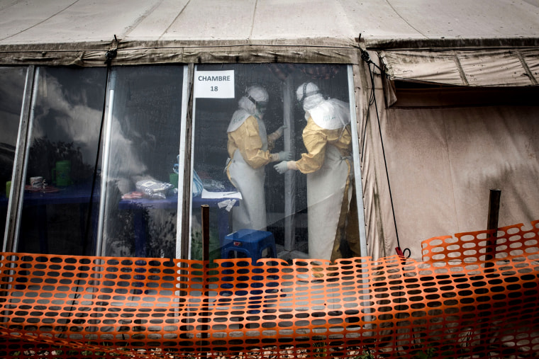 "Image: Health workers are seen inside the ""red zone"" of an Ebola treatment center in Butembo in the Democratic Republic of Congo on March 9, 2019."