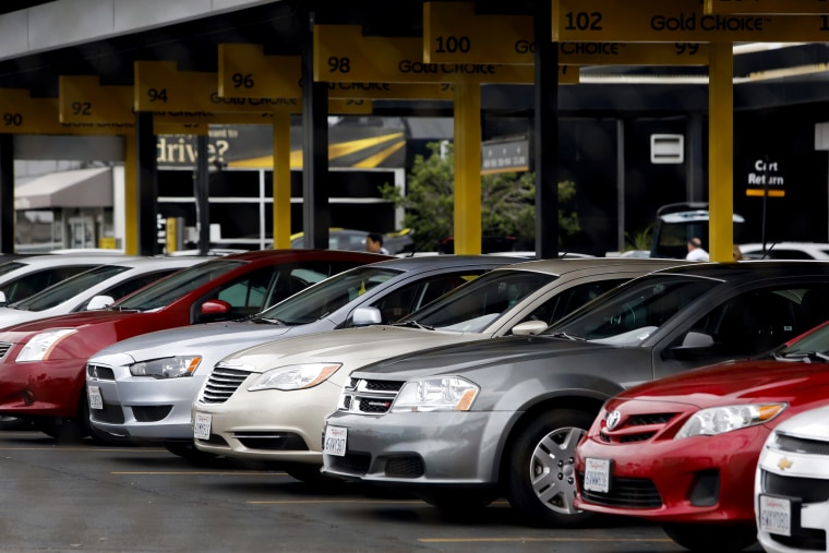 Image: Rental cars sit in a lot at Los Angeles International Airport in California in 2013.