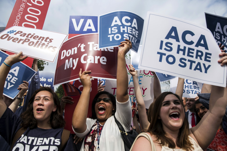 Image: Supporters of the Affordable Care Act celebrate after a Supreme Court ruling upholding the law in Washington on June 25, 2015.