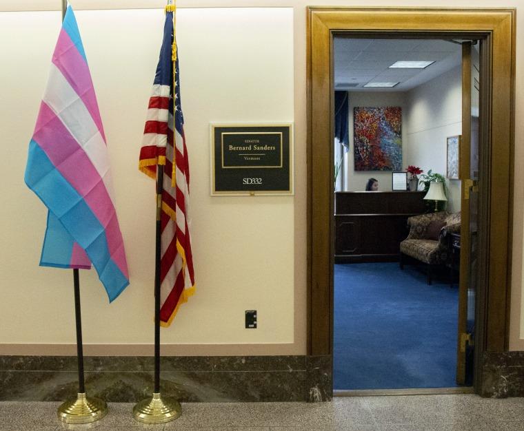 Image: A transgender pride flag stands outside of Sen. Bernie Sanders' office in Washington.
