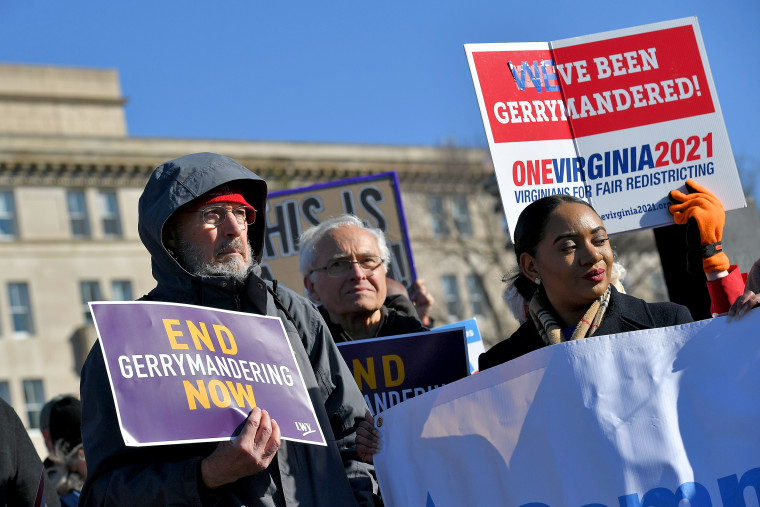People gather during a rally to coincide with the Supreme Court hearings on the redistricting cases in Maryland and North Carolina, in front of the U.S. Supreme Court in Washington on March 26, 2019.