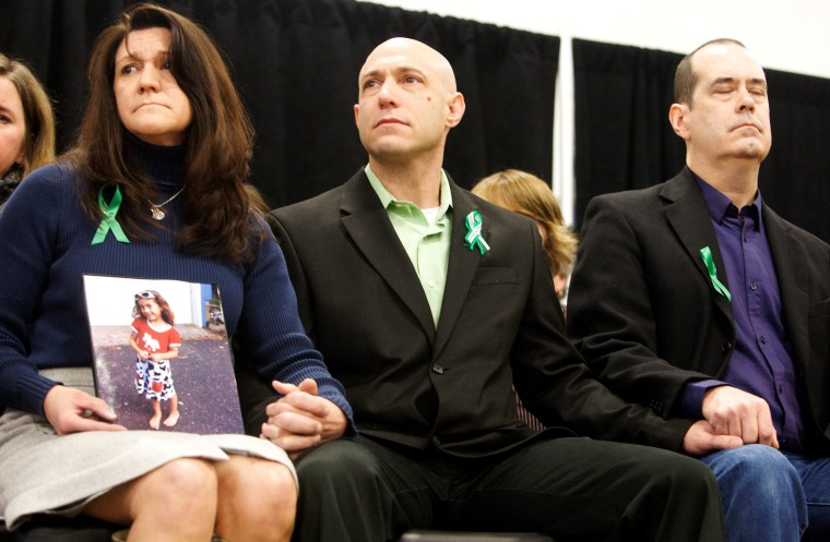 Image: Jennifer Hensel and Jeremy Richman, the parents of Avielle Richman, sit with David Wheeler at the launch of The Sandy Hook Promise in Newtown, Connecticut, on Jan. 14, 2013.