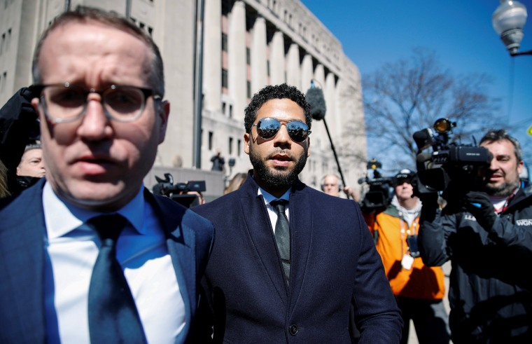 Image: Actor Jussie Smollett leaves court after charges against him were dropped by state prosecutors in Chicago
