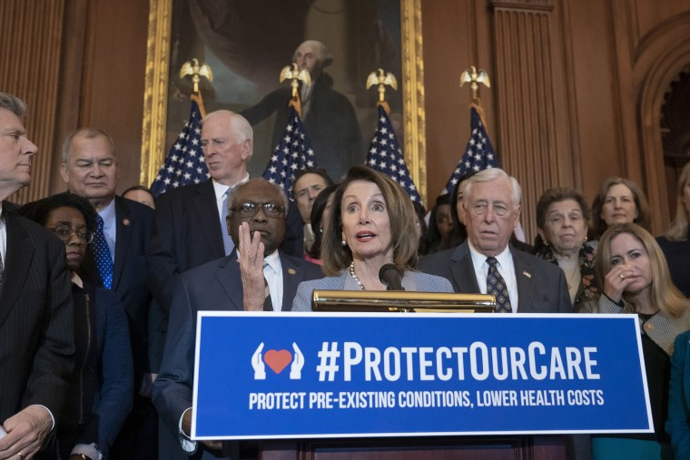 Image: Speaker of the House Nancy Pelosi, D-Calif. leads an event to announce legislation to lower health care costs and protect people with pre-existing medical conditions, at the Capitol