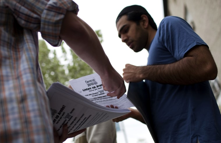 Image: Fliers encouraging Arab-Americans to fill out census forms are handed out in Bay Ridge, New York, on April 9, 2010.