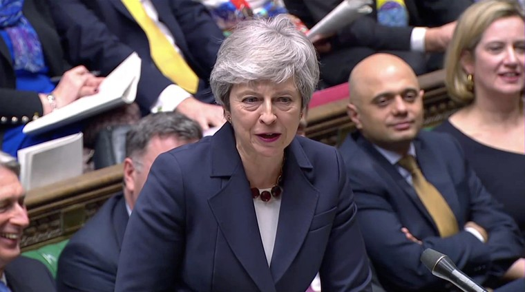 Image: Britain's Prime Minister Theresa May answers questions in the Parliament in London