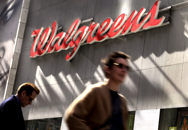 Image: People walk by a Walgreens in Times Square in New York on Oct. 17, 2012.
